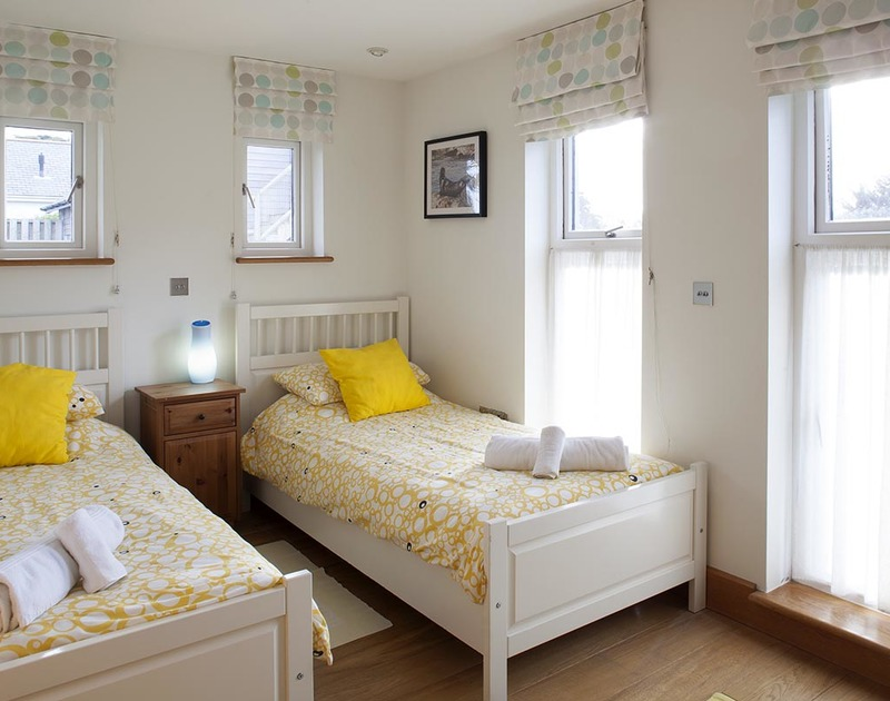 A cheerful and light twin bedroom at Ossco, is set on the first floor adjacent to the bunk room