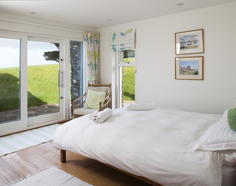 The airy lower floor double room at Ossco, offers a comfortable and peaceful escape with access onto the garden