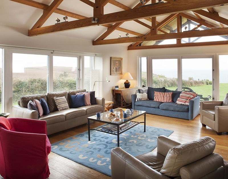 The laid back coastal decor does not detract from the mesmerising sea views at Ossco, a luxury holiday house to rent in Polzeath, north Cornwall