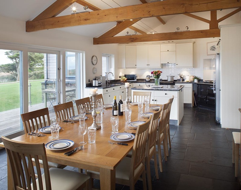 Dine in style in the open plan kitchen diner at Ossco, a holiday house in Polzeath with sensational sea views