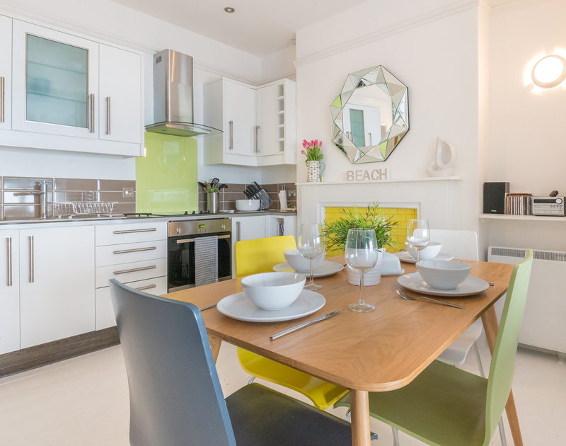 The pastel chic designed kitchen diner at The View, a contemporary self catering holiday apartment in Port Isaac, Cornwall.