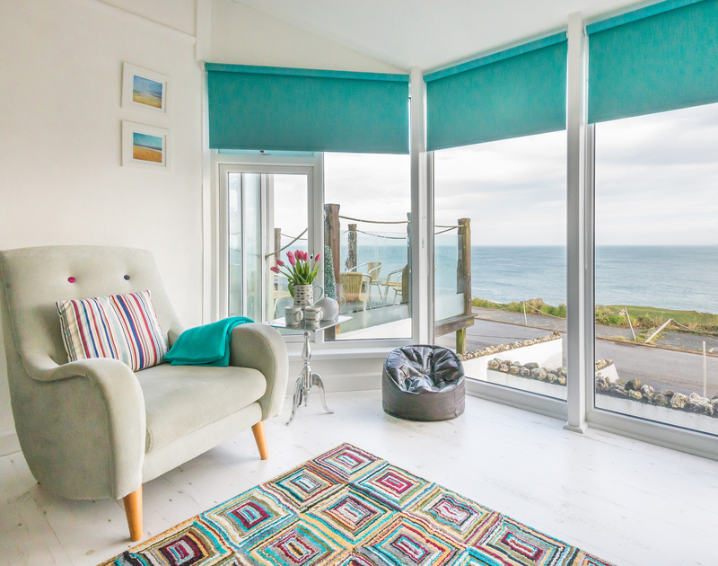 Relax in the lounge with the breathtaking views of the coast at The View, a contemporary self catering holiday home in Port Isaac, Cornwall.