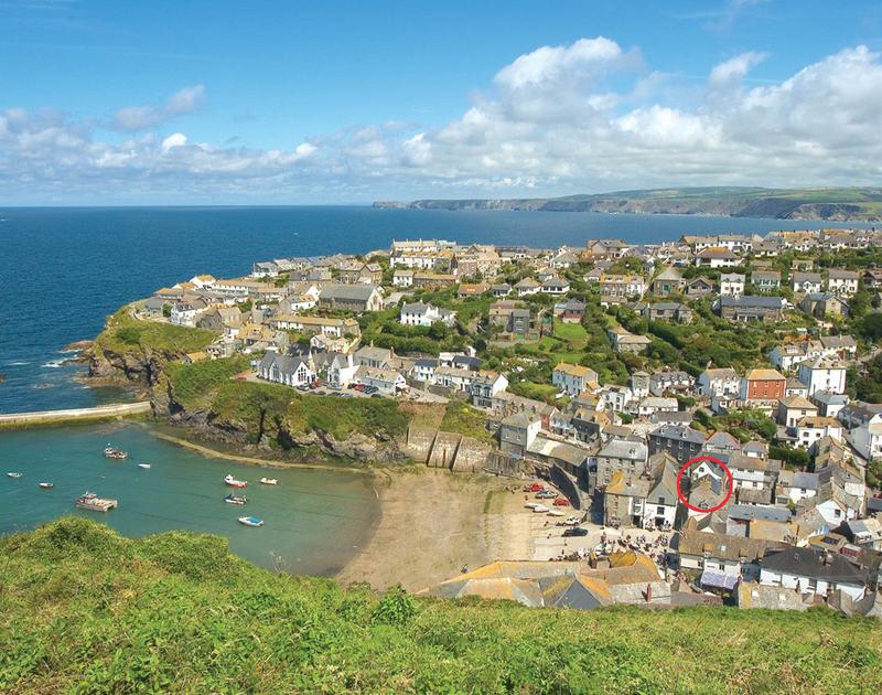 The view from Roscarrock Hill of the beach harbour at Port Isaac, showing location of Cloam Cottage, a holiday rental in North Cornwall.