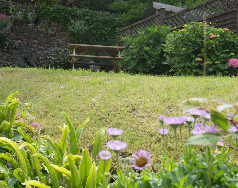 The secluded back garden at Poplar Cottage, a traditional self catering cottage in Port Isaac, Cornwall.