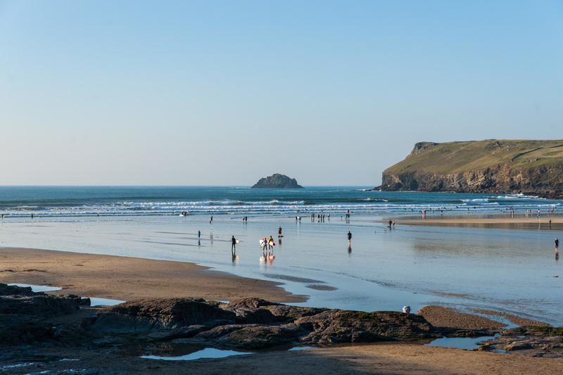 The starting point at Polzeath's blue flag beach looking towards Pentire Point with Newlands in the distance
