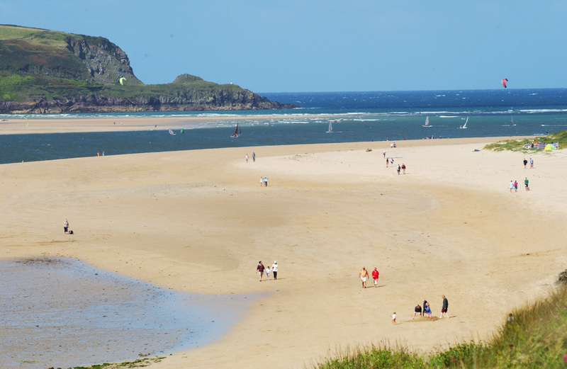 The mile long stretch of golden sand stretching from Rock to Daymer Bay in Cornwall, is dog friendly and follows the protected Camel Estuary