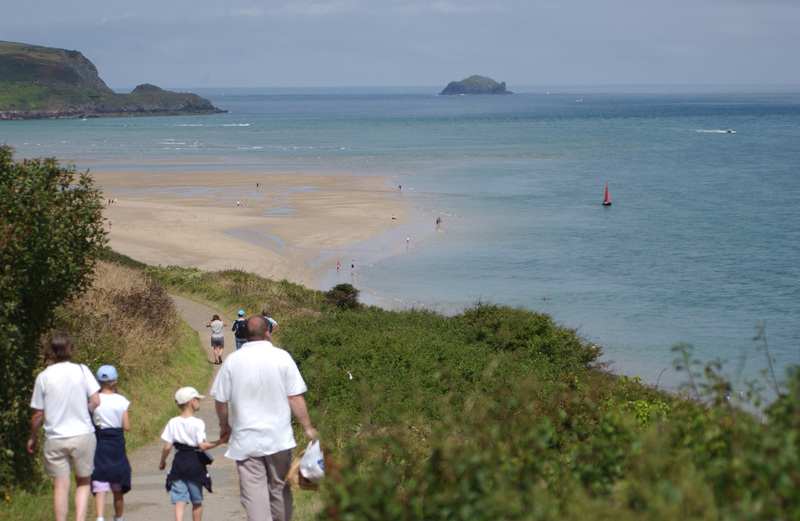 Families will enjoy the walk to Hawkers cove from Padstow on the Camel Estuary with Newlands in the distance