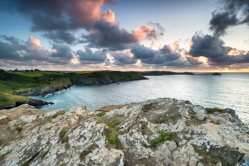 The sunset view of Epphaven Cove taken from Trevan Point with Pentire and the Mouls in the distance