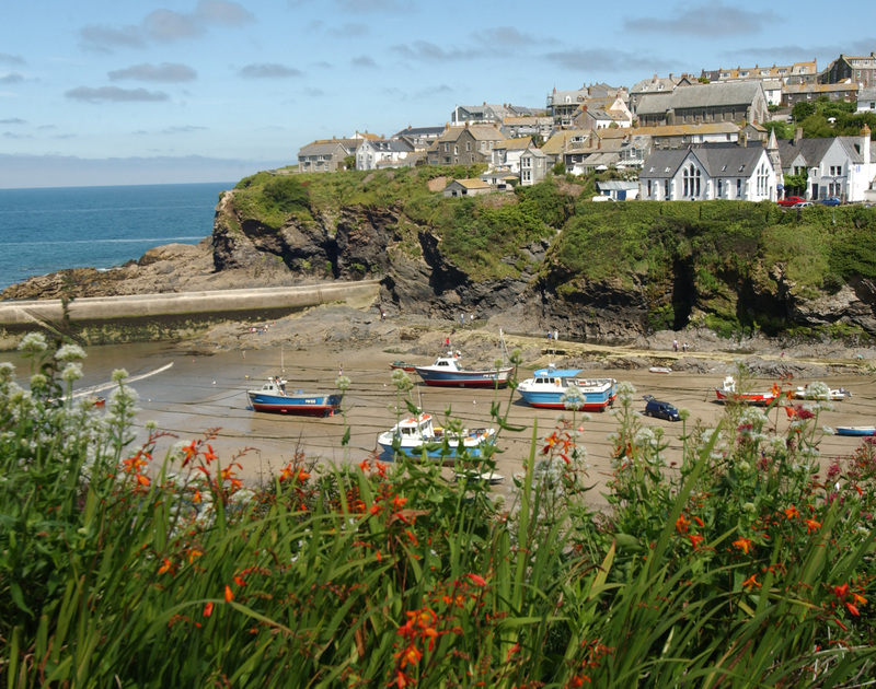The coastal walks offer wonderful views of the colourful fishing boats in Port Isaac harbour at low tide