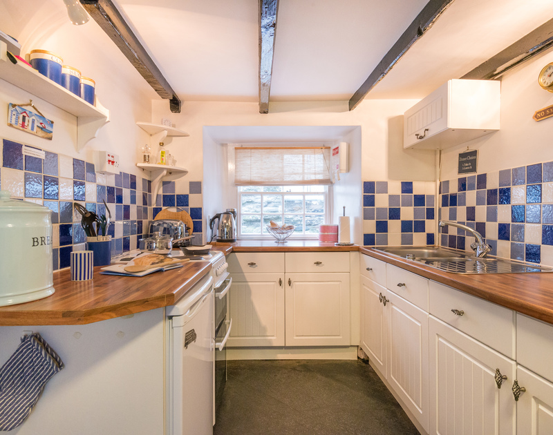 Enjoy some peaceful cookery in this lovely blue and white themed kitchen at Cloam Cottage,