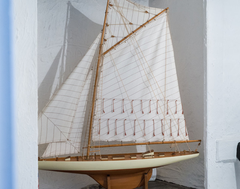 Charming maritime style decor includes this model yacht at Cloam Cottage