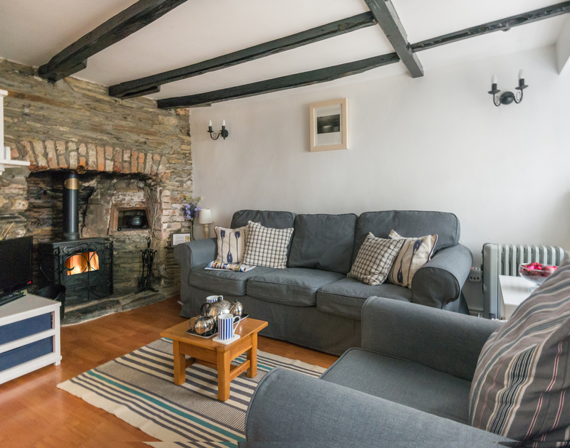 On a chilly night, light the woodburner in the sitting room of Cloam Cottage, a holiday let in Port Isaac