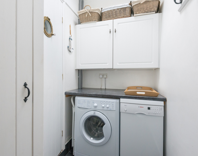 A small but useful utility room with washing machine at Cloam Cottage