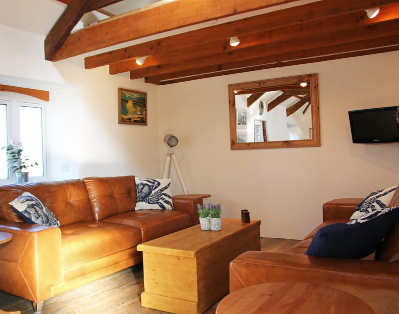 Two spacious sofas provide plenty of comfortable seating for relaxing in An Skyber Barn.