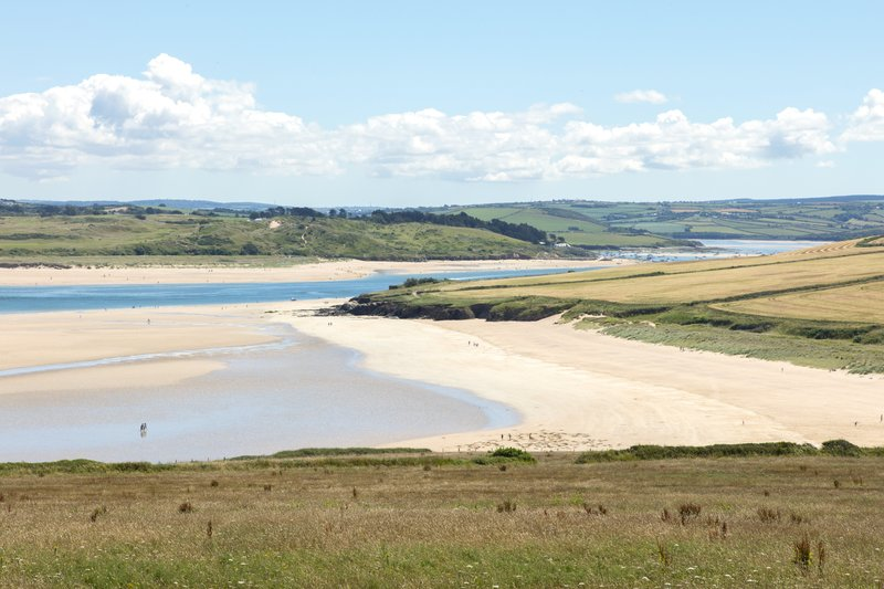 Looking back to Harbour Cove, known locally as Tregirls Beach, on the Camel Estuary with Rock in the distance