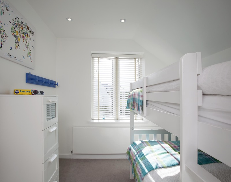 The bright and airy children's bunk bedroom at 3 The Sands, a holiday cottage in Polzeath, Cornwall
