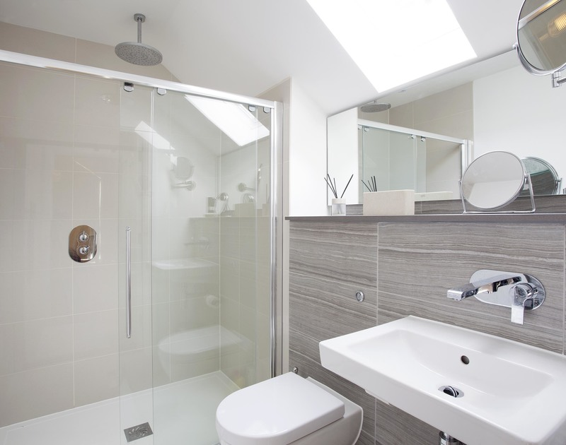 The sleek bathroom with huge shower in 3, The Sands, a luxurious self catering holiday house in Polzeath, North Cornwall.