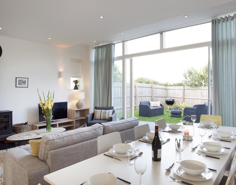 Experience sophisticated coastal living in the open plan living and dining area at 3 The Sands, in Polzeath, Cornwall