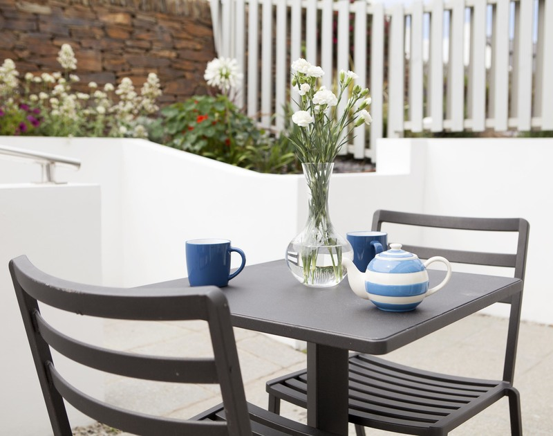 Just off the kitchen at 5 The Sands, is a sunny spot to enjoy morning tea as you plan the day.
