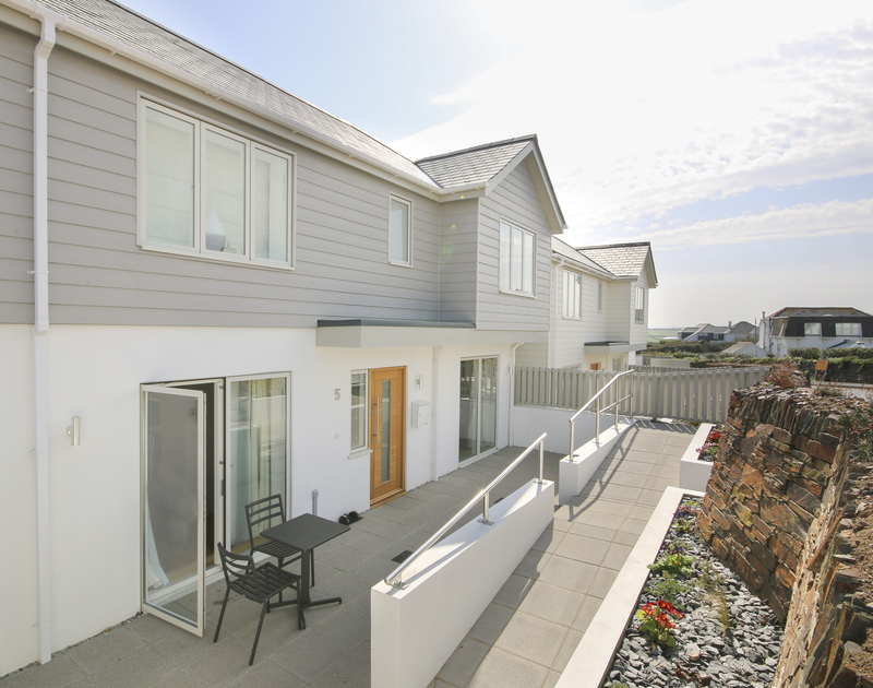 The front elevation of 5 The Sands near Polzeath, has a traditional Cornish stone wall and ramped access to the property