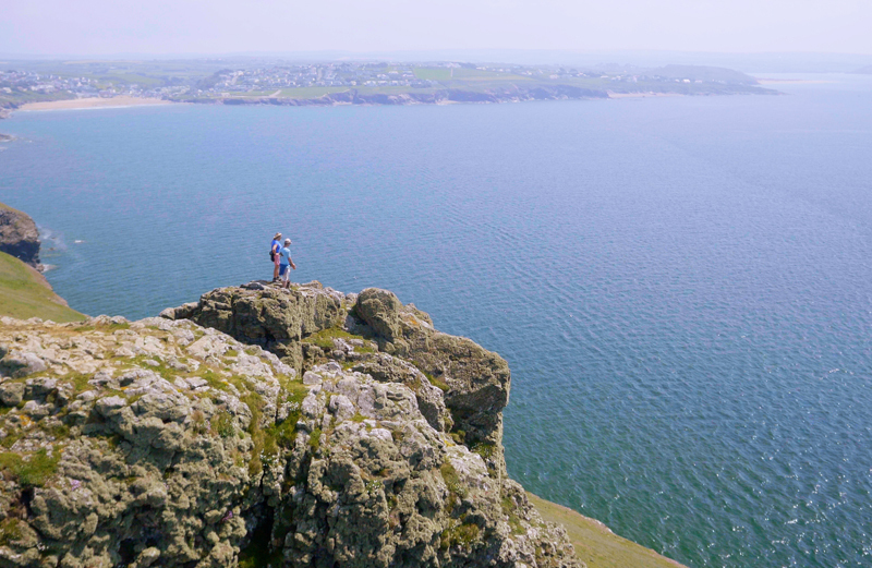 Feeling on top of the world at Pentire Point on the South West Coast Path with Polzeath to the left and Daymer to the right and the mouth of the Camel Estuary beyond