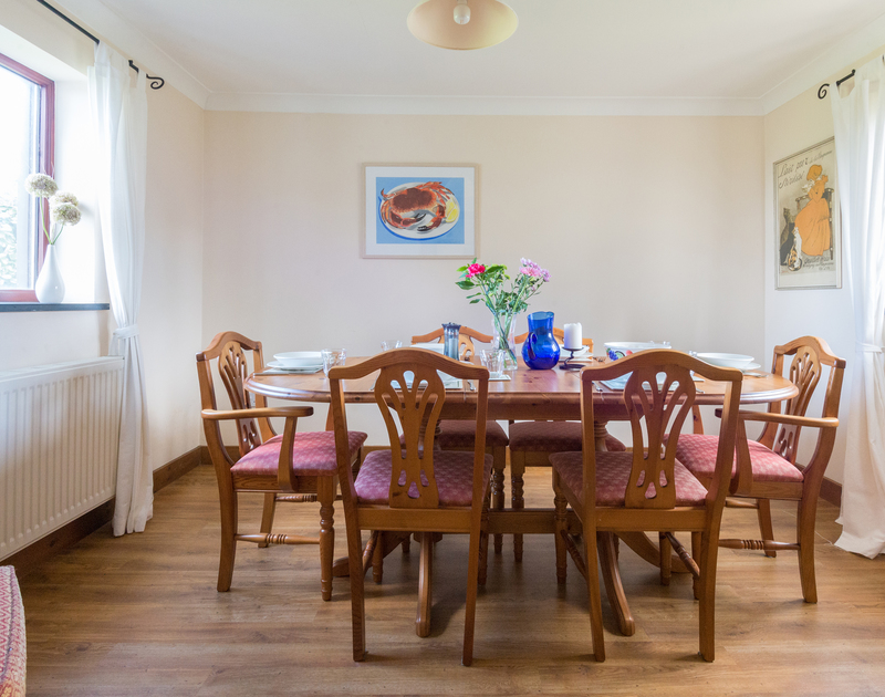 Easy holiday suppers around the pinewood dining table at Dolphin Cottage