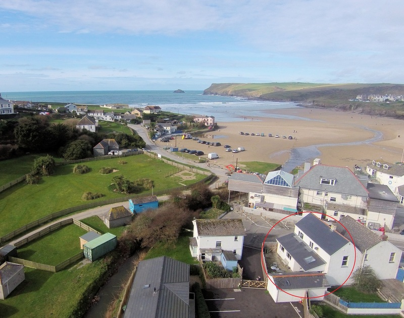 An aerial view of Hagervor House in the centre of the village beside the  beach and sea at Polzeath in North Cornwall.