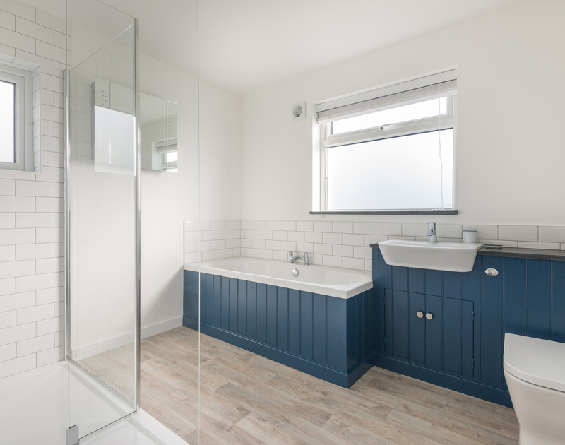The light and spacious family bathroom at Tide Race in Daymer Bay has a bath and shower.