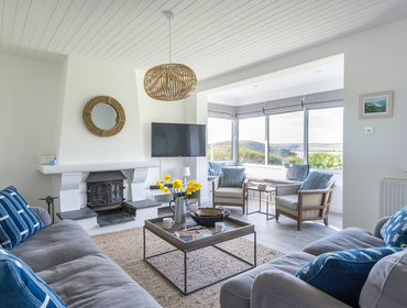 The spacious and light filled living room at Tide Race, Daymer Bay with glorious views over Daymer Bay and the Camel Estuary in North Cornwall.