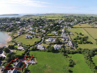 An aerial photo showing the house, annexe and private off road parking at Porthilly Greys, a traditional holiday cottage in Rock, Cornwall