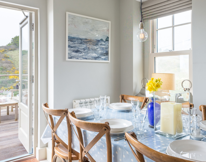 The stylish dining area in Westray House, a self catering holiday cottage in Polzeath, North Cornwall.
