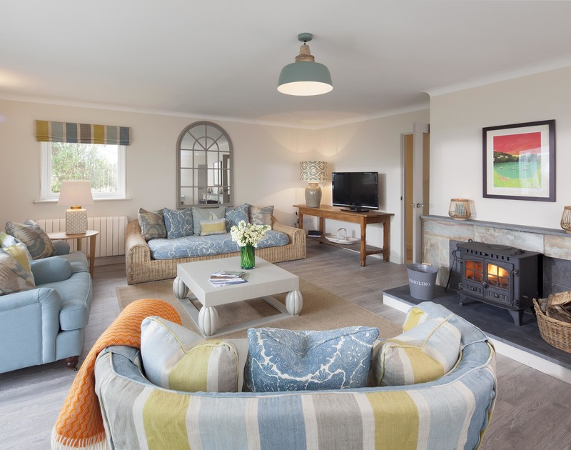 Curl up by a roaring log fire at Brae Heights in Daymer Bay, North Cornwall after a busy day on the beach