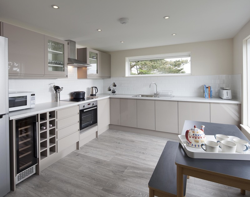 The beautiful and newly refurbished kitchen at Brae Heights has a convenient breakfast table and wonderful views