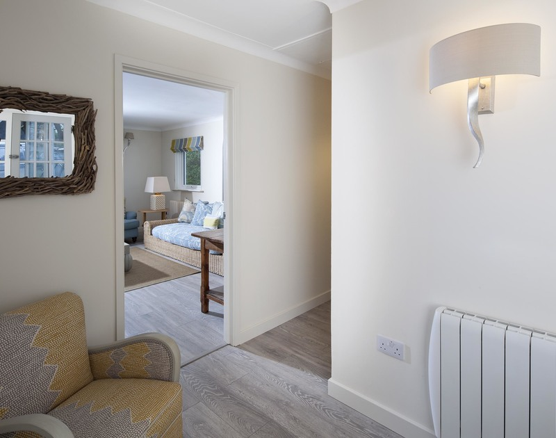 The light hallway and a glimpse of the spacious living room at Brae Heights, a self catering, newly refurbished, holiday house in walking distance of many of North Cornwall's beautiful beaches.