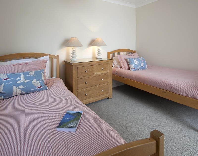 The nautically themed, pretty twin bedroom at Brae Heights.