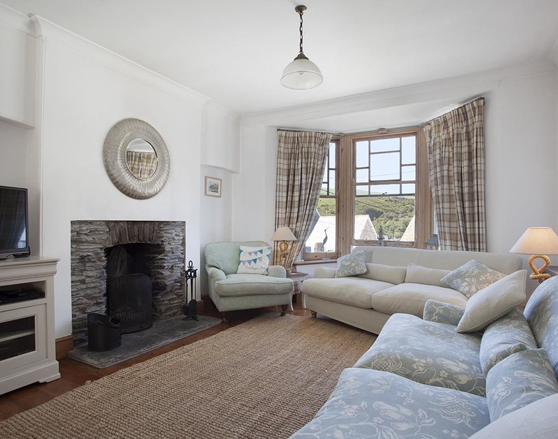 The comfortable and contemporary sitting room in Fronthill House, a self catering holiday cottage in Port Isaac, Cornwall.