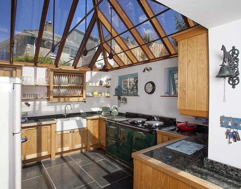 The spacious kitchen has a glass-vaulted ceiling at Fronthill House, a self-catering holiday cottage in Port Isaac, Cornwall