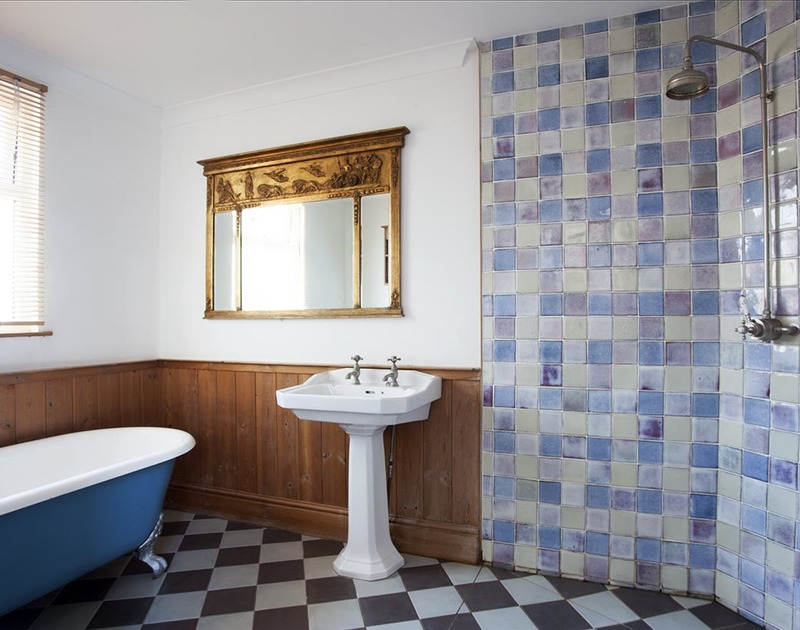 The family wet room with a freestanding bath and separate open shower on the first floor in Fronthill House, a traditional self catering holiday cottage in Port Isaac, Cornwall