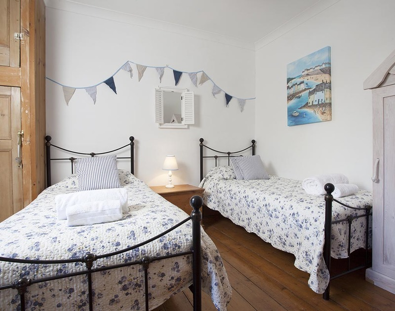 The seaside inspired first floor twin bedroom in Fronthill House, a traditional self catering holiday cottage in Port Isaac, Cornwall