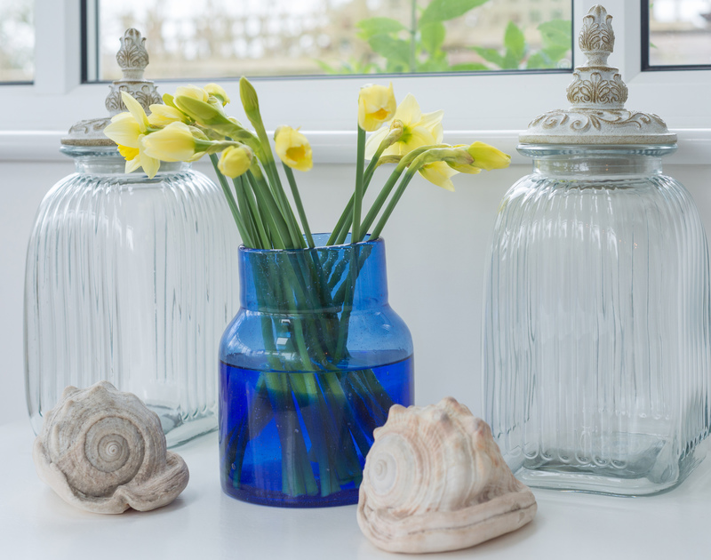 Pretty styling and seaside accessories in the conservatory at Scarthoe