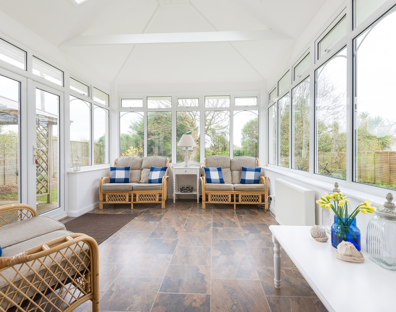 The sunny conservatory in Scarthoe, a self catering holiday house to rent in Rock, Cornwall.