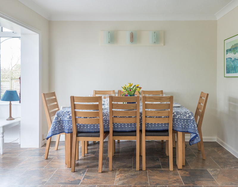 Scarthoe's dining table in the kitchen/diner, leading through to the conservatory