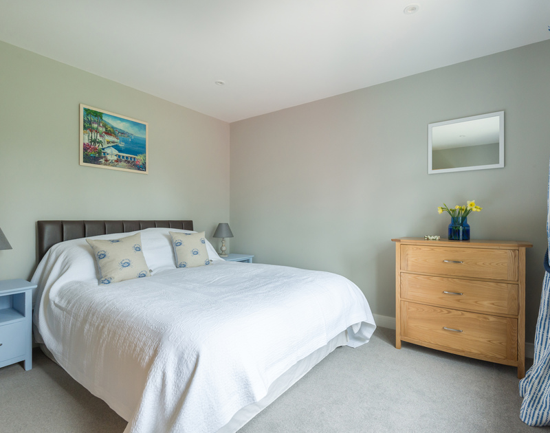 Ground floor double bedroom at Scarthoe, self-catering holiday rental in Rock, with kingsize bed