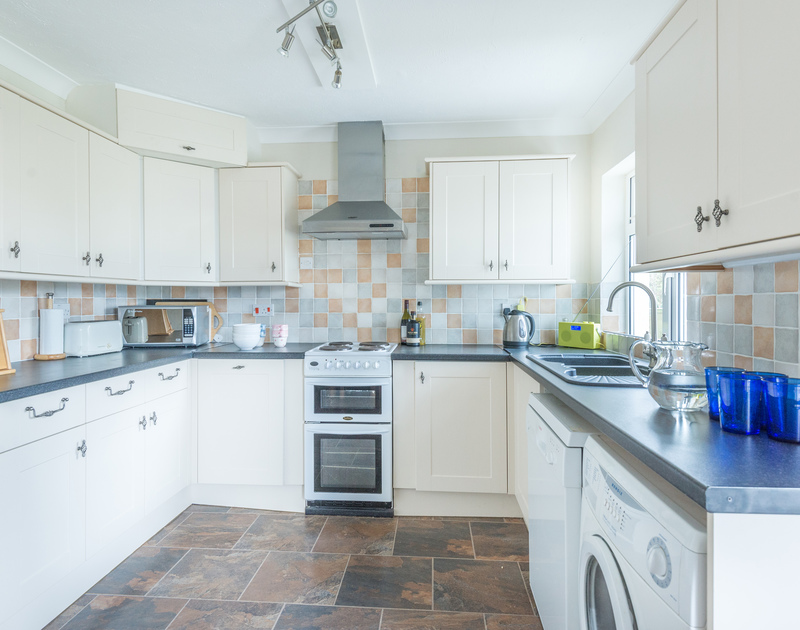 The modern, practical kitchen at Scarthoe, essential for easy holiday catering.