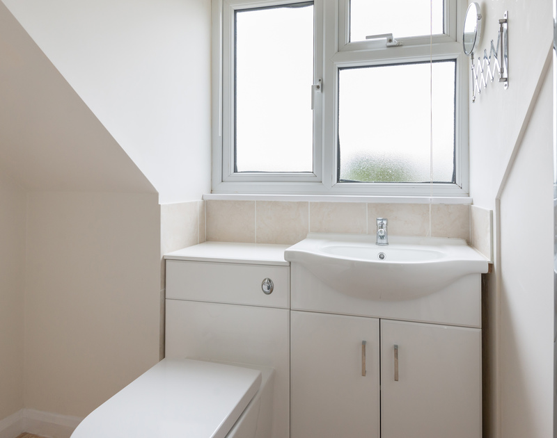 First floor bedroom ensuite shower room at Scarthoe, with cupboard under basin