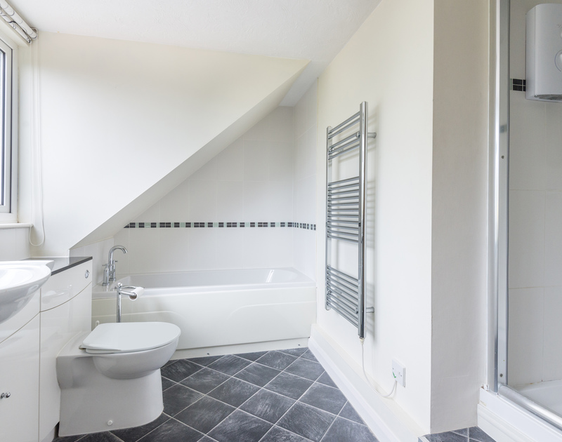 The family bathroom of Scarthoe, with freestanding shower and heated towel rail