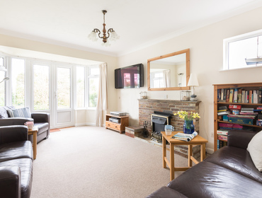 The light, spacious  lounge in Scarthoe, a self catering holiday house in Rock, North Cornwall.