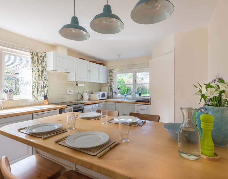 The light, cheerful, open-plan kitchen/diner of Little Torquil,a  characterful and cosy holiday rental at Daymer Bay, Cornwall