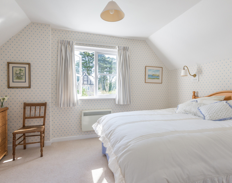 The prettily decorated double bedroom at Little Torquil, an appealing holiday cottage at Daymer Bay, Cornwall