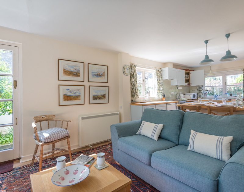 The perfect place to sit and relax with a coffee in the lounge area at Little Torquil, a contemporary self catering holiday cottage in Daymer Bay, North Cornwall.